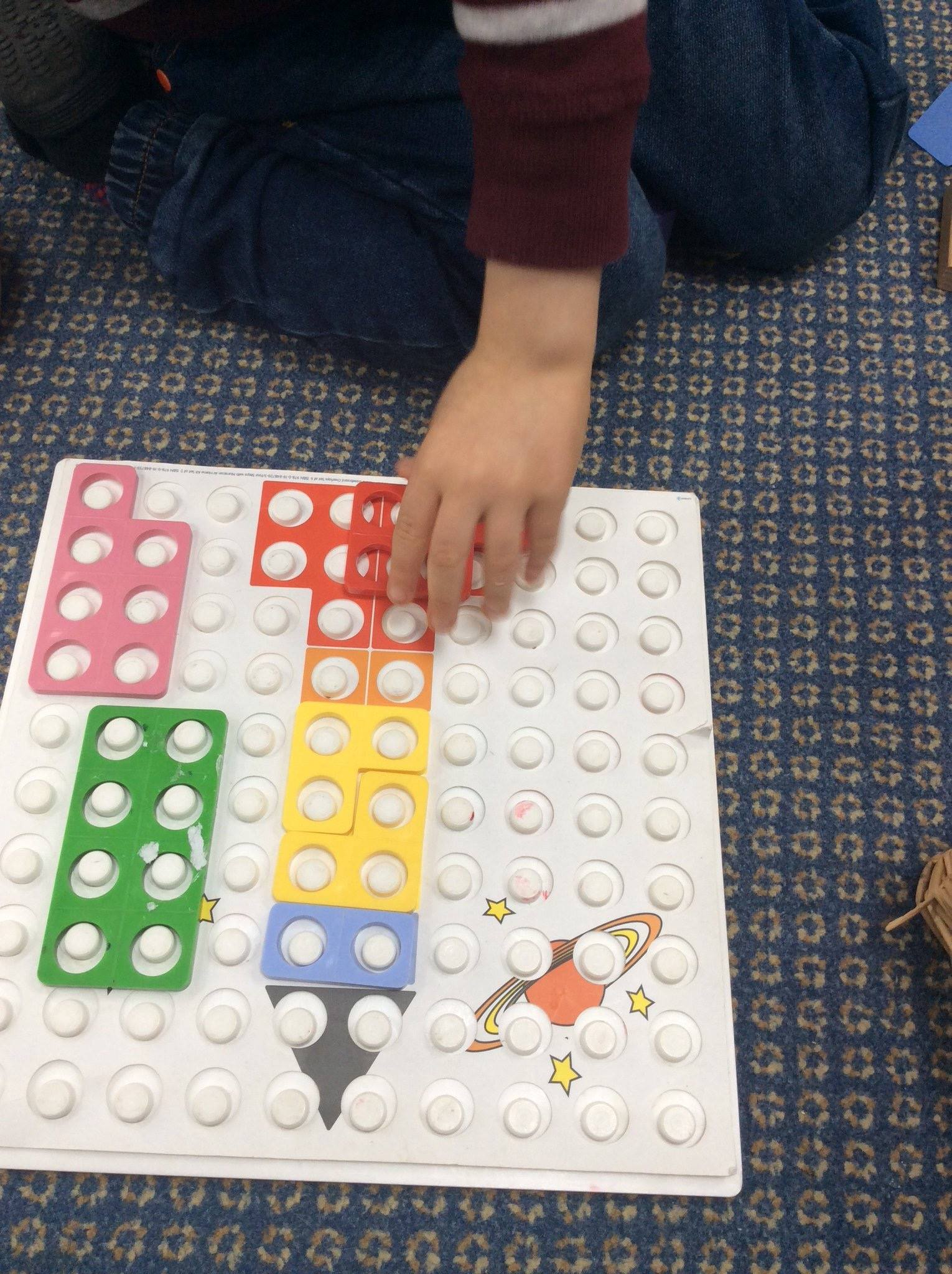 Picture of child using numicon