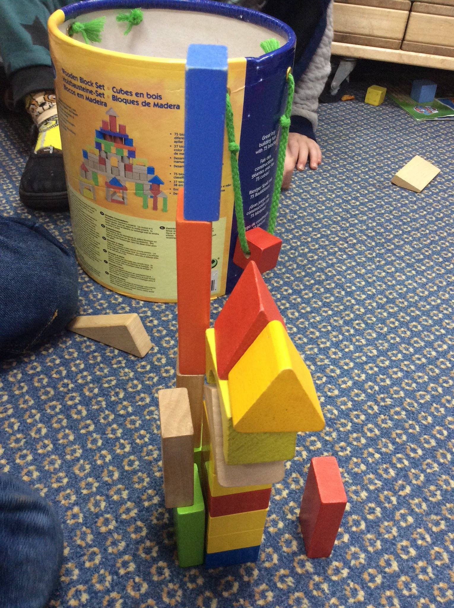 Picture of child making towers with blocks